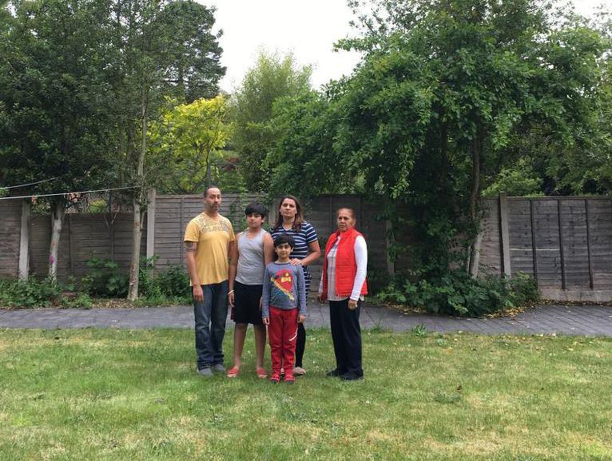 Sukhpreet and her family in their garden, which the proposed extension would have overlooked