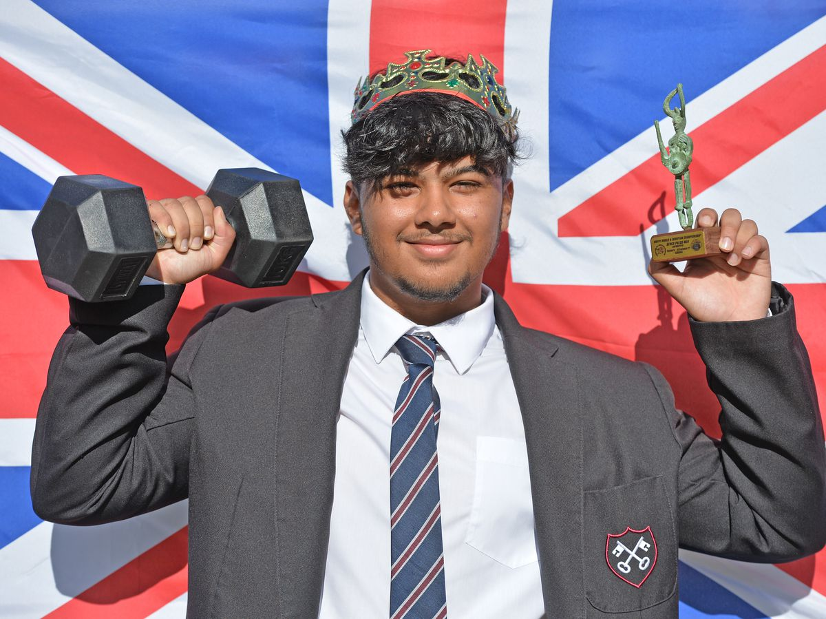 World Champion Powerlifter Joshua Basham with his trophy after being made king for the day at St Peters School