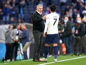 Aston Villa manager Dean Smith (left) shake hands with Tottenham Hotspur's Son Heung-min