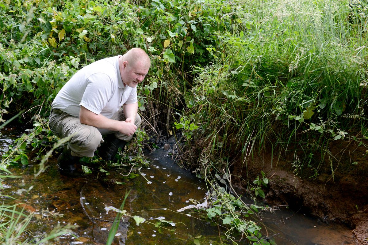 Edward Hughes from Pencroft Lane who has reported raw sewage entering a brook at the bottom of his garden.  The grey sewage entering the brook..