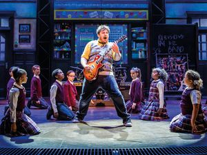 Jake Sharp, from Lichfield, stars as Dewey Finn in School of Rock - coming to the Grand Theatre this week