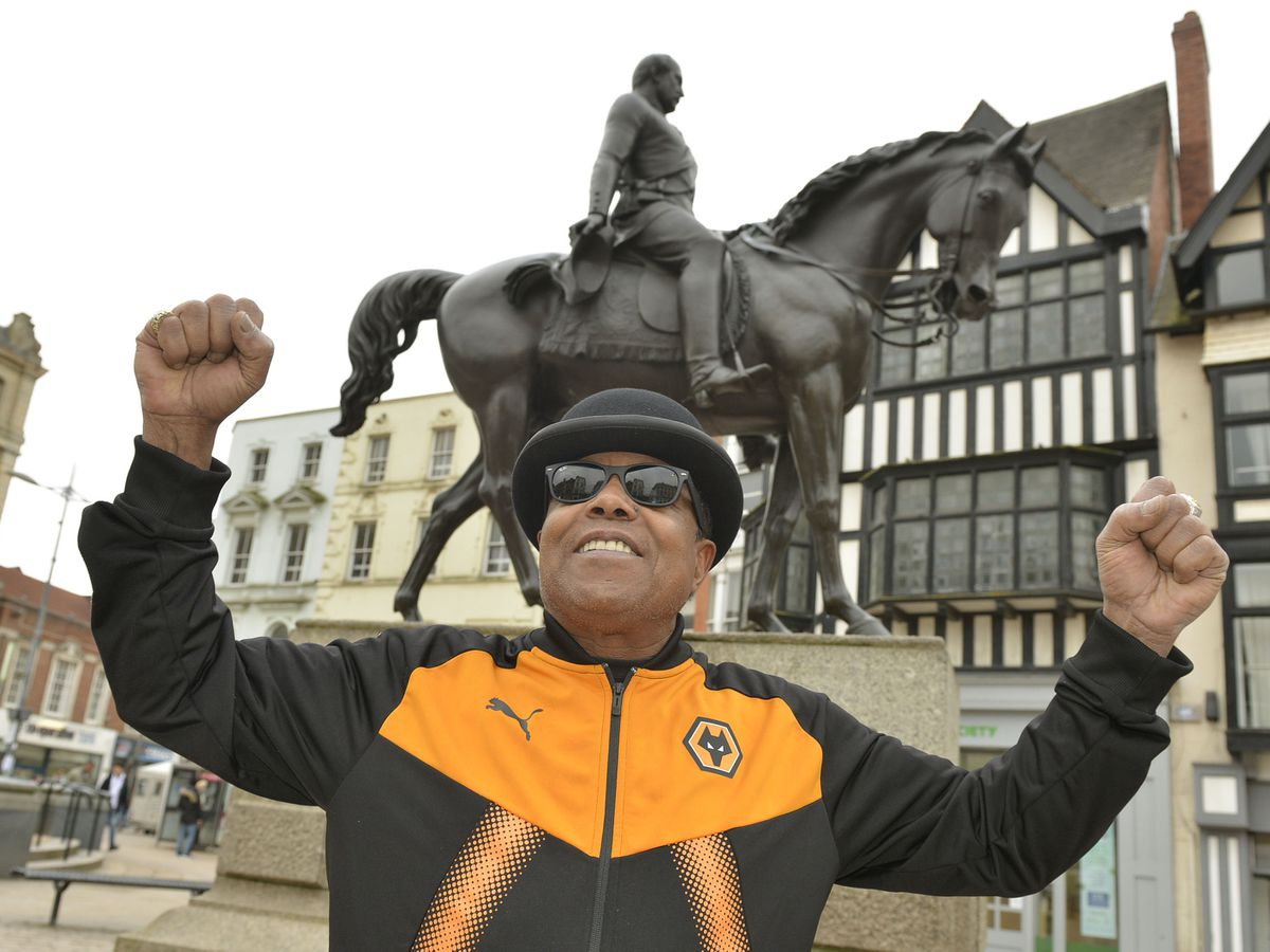 Look who's back! Tito Jackson in his Wolves tracksuit next to the Man on the Oss statue in Wolverhampton city centre