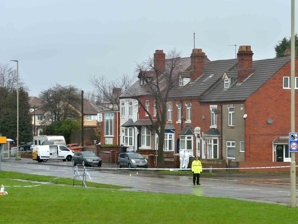 Road remains cordoned off amid ongoing double murder investigation