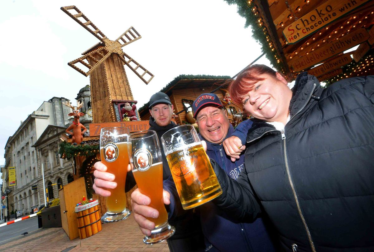 Susan Small with Gerry Purnell and Lee Jones from Moseley celebrate the return of the Frankfurt Christmas Market. All pictures: Steve Leath