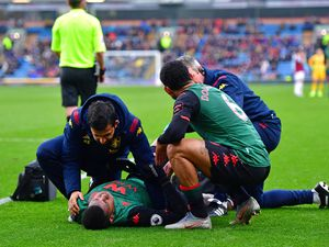 Aston Villa's Wesley receives treatment after an injury during the Premier League match at Turf Moor, Burnley.