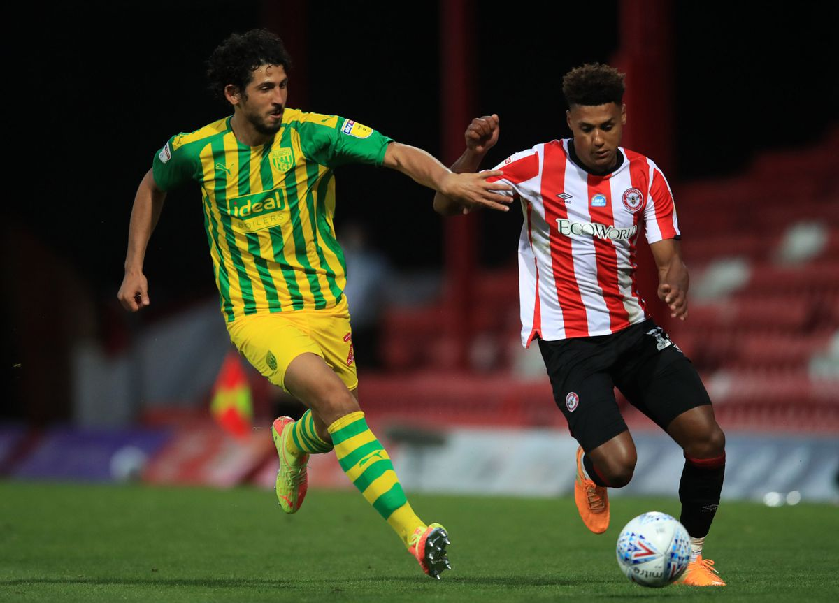 Brentford's Ollie Watkins (right) and West Bromwich Albion's Ahmed Hegazi