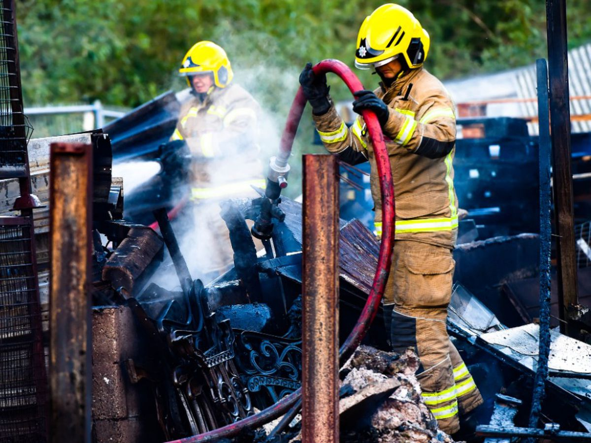 Firefighters tackle the blaze. Photo: SnapperSK