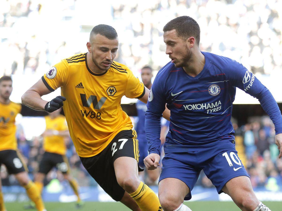 Romain Saiss keeps an eye on Eden Hazard at Stamford Bridge