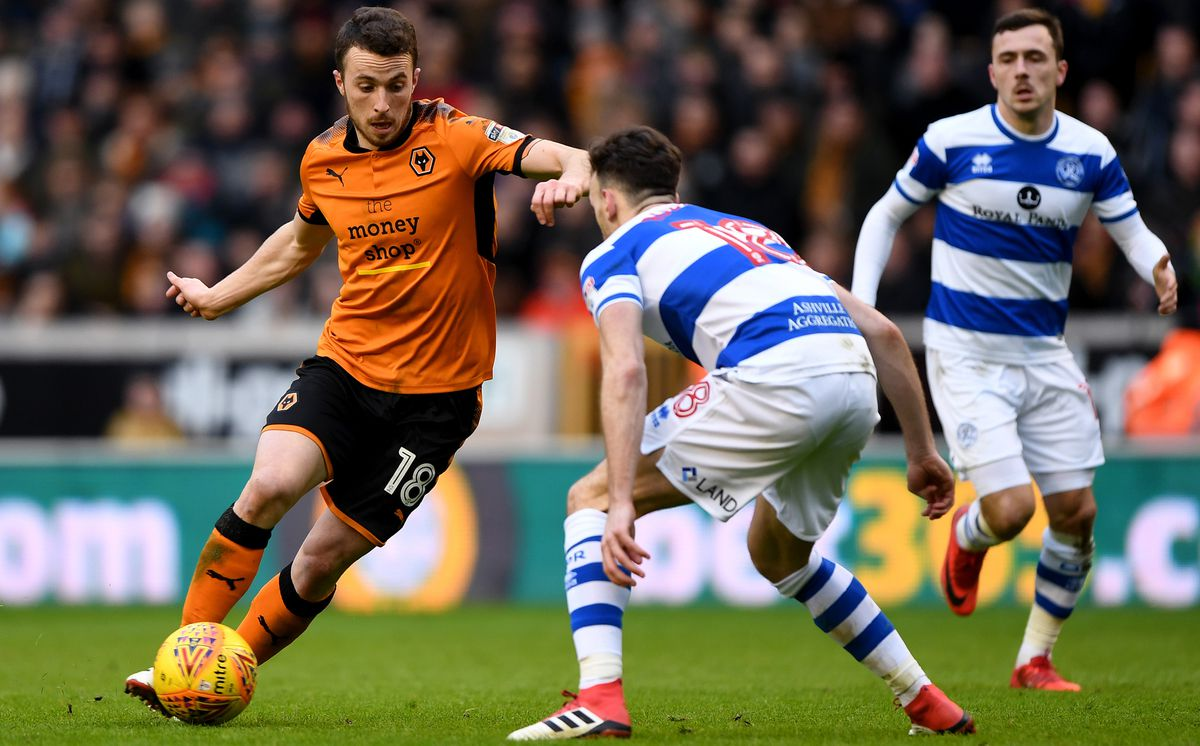 Diogo Jota takes on Robinson during Saturday's game. Pic: AMA.