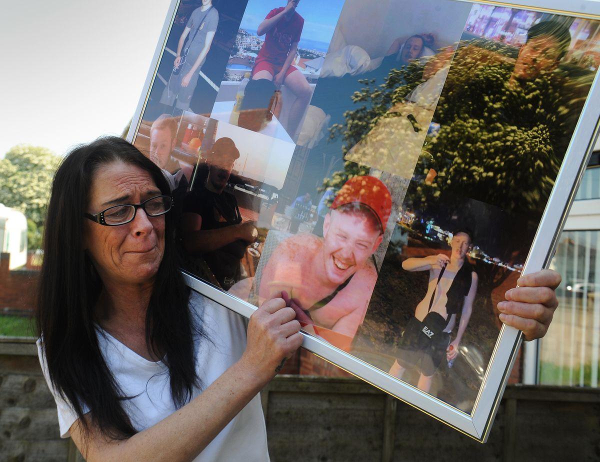 Shane's mother Dawn Bennett looks at photographs of her son