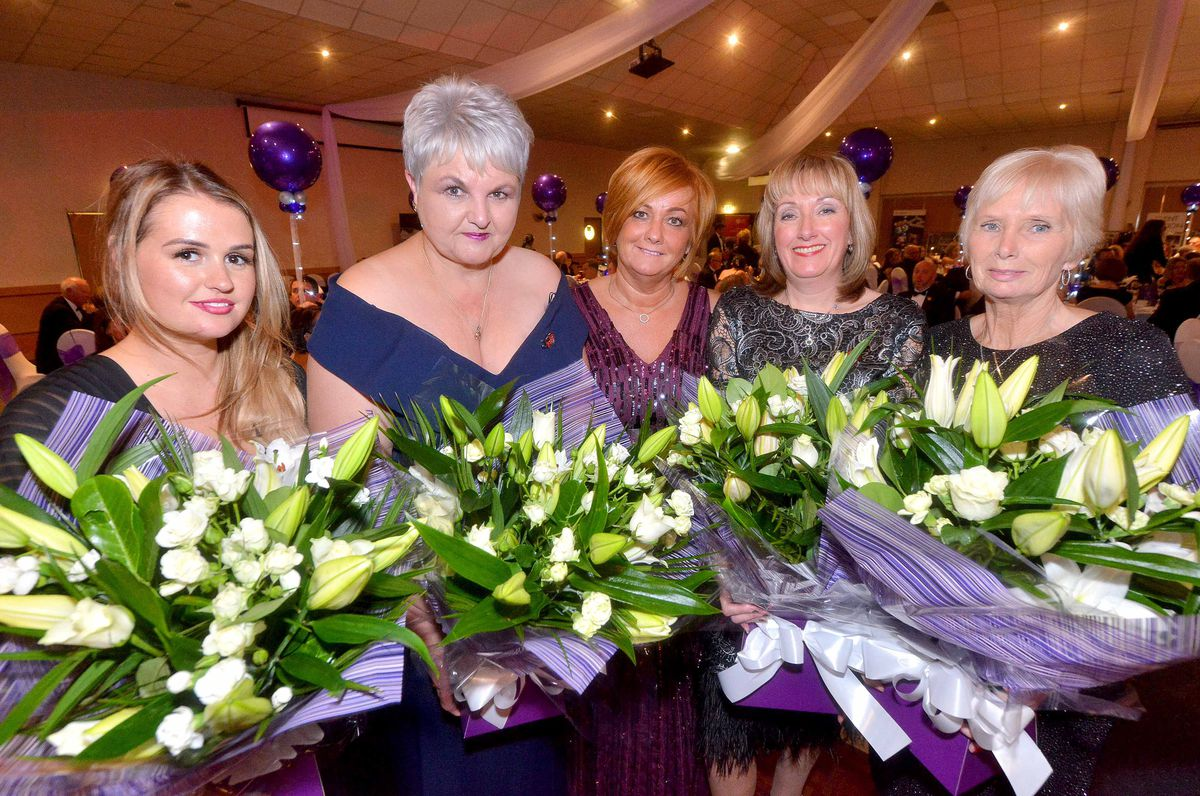 Suzy Evans presents flowers to Chloe Albrighton, Cheryl Stollery, Julie Grubb and Joyce Hibbs, who all lost loved ones