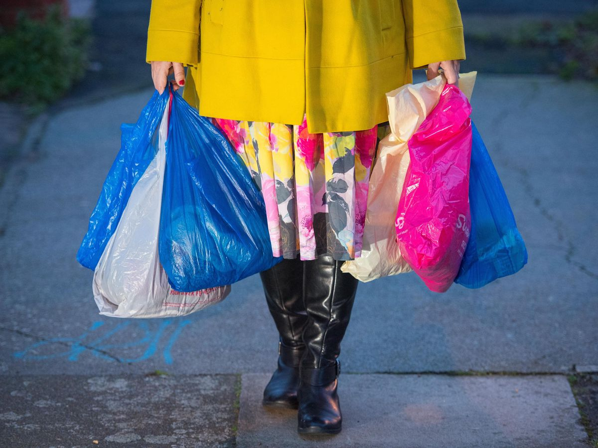 A shopper with single use carrier bags