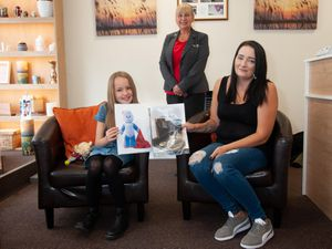 Holding pictures of the new memorial and the Iggle Piggle design which will be inscribed on it are Kelly Turner (right) with her daughter Ruby Mai  with Halliwell Coseley funeral director Yvonne Harper