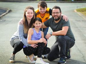 11-year-old Imogen Leith, with her sister Rebecca (left), brother Josh, and her father Richard.