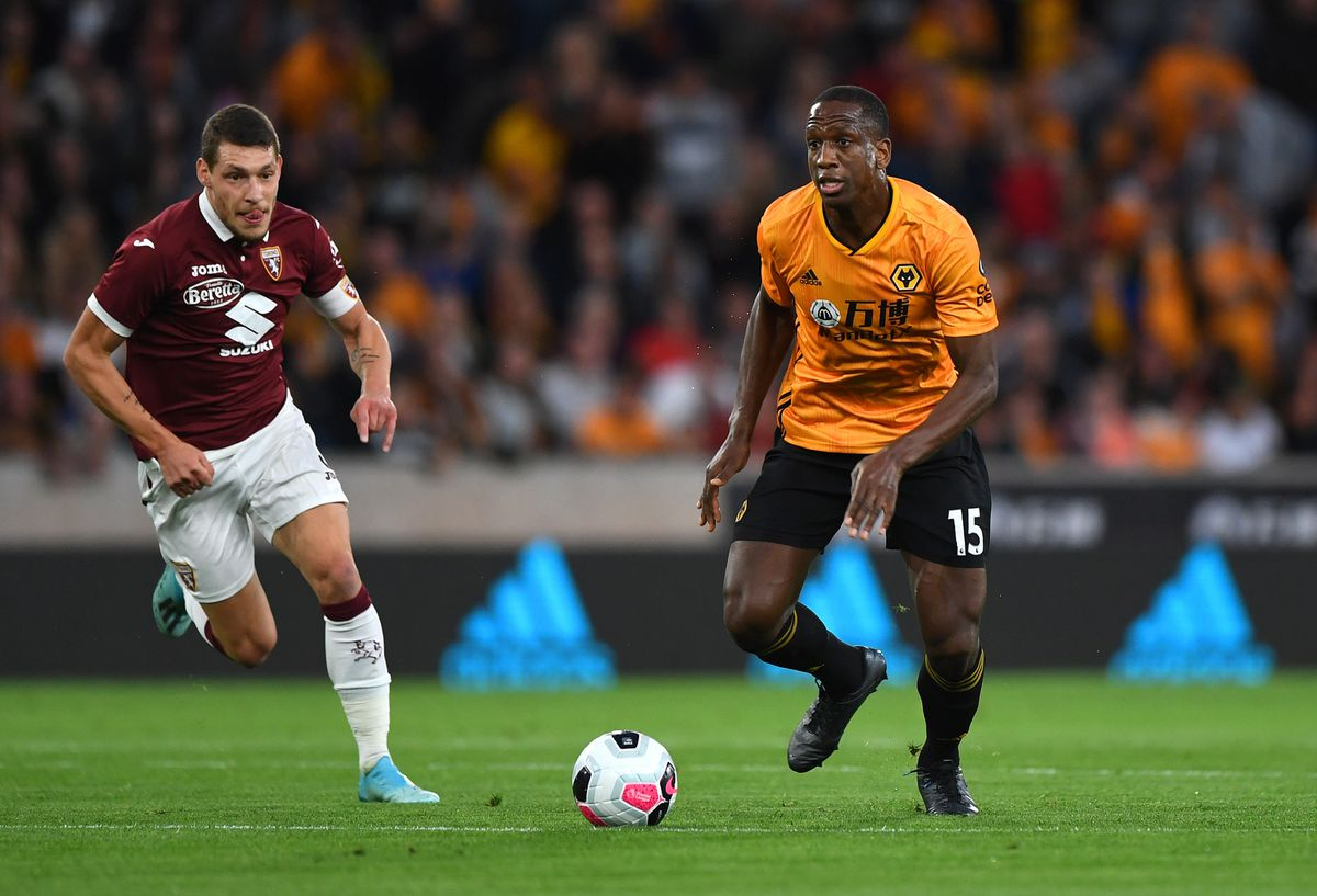 Andrea Belotti of Torino and Willy Boly (AMA)