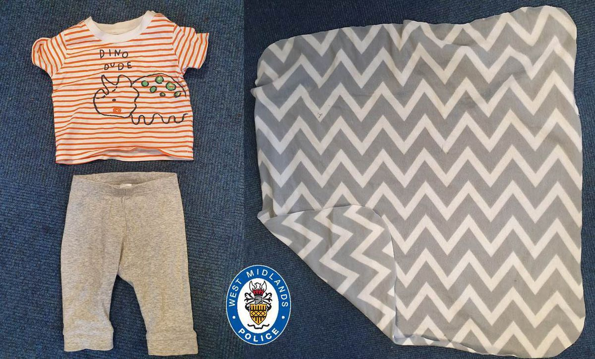 Baby George was wearing grey leggings and an orange and white striped t-shirt when he was found
