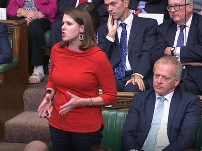 Jo Swinson heckled as she defends decision to let Tory MP defect to Lib Dems