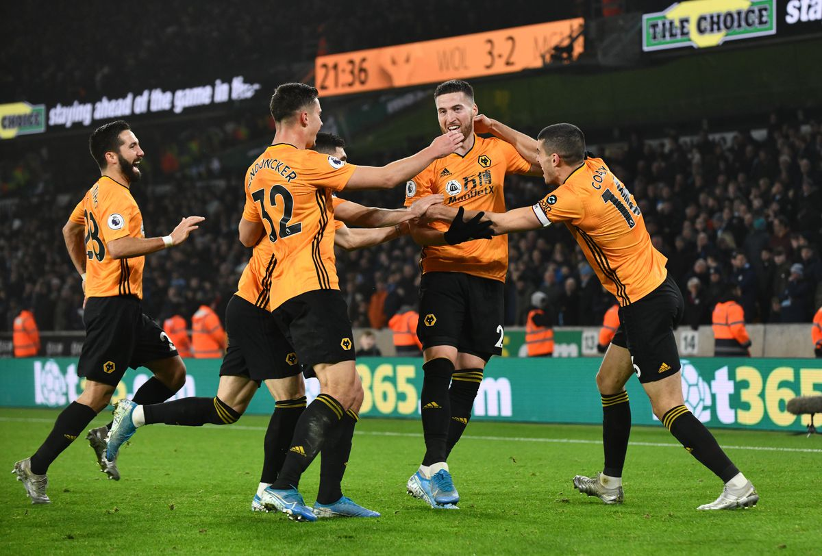 Leander Dendoncker congratulates Matt Doherty as the Wolverhampton Wanderers players celebrate making it 3-2