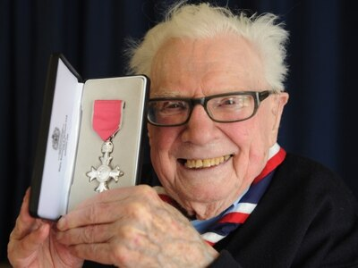 Proud Scout leader Derek given MBE aged 96 - WATCH