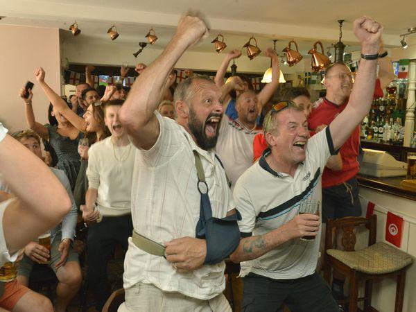 Celebrating England's win against Sweden at the Old Bush Inn in Albrighton