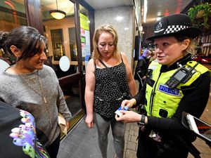 Assistant Chief Constable Claire Bell speaking to Amrita Sethi and Sarah Smallman in Wolverhampton city centre