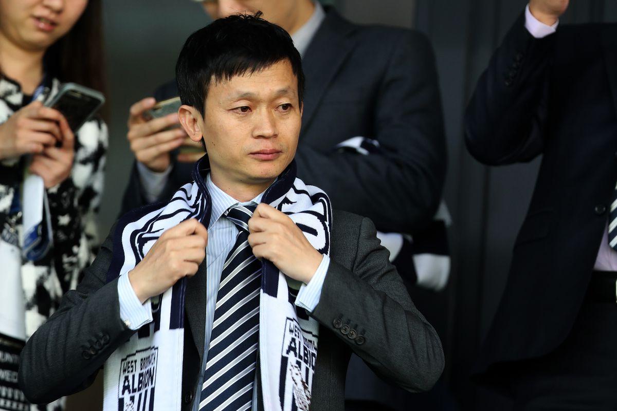 Guochuan Lai at Albion's game with Tottenham last season.