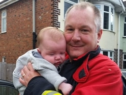 Baby rescued after being locked in car