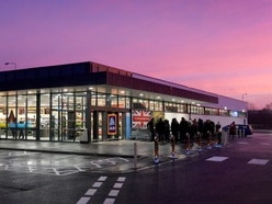 Eager shoppers brave cold to queue for opening of new Aldi