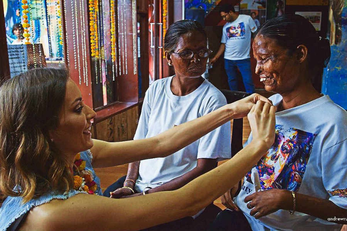 Natalie meets acid attack victims in India as part of her documentary Not in Vain