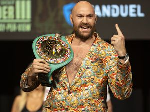 Tyson Fury poses during a news conference