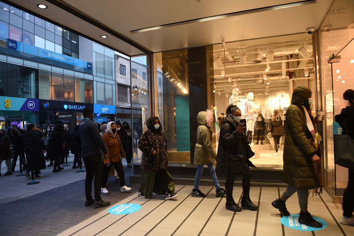 Early morning shoppers queue to get into Primark in Birmingham