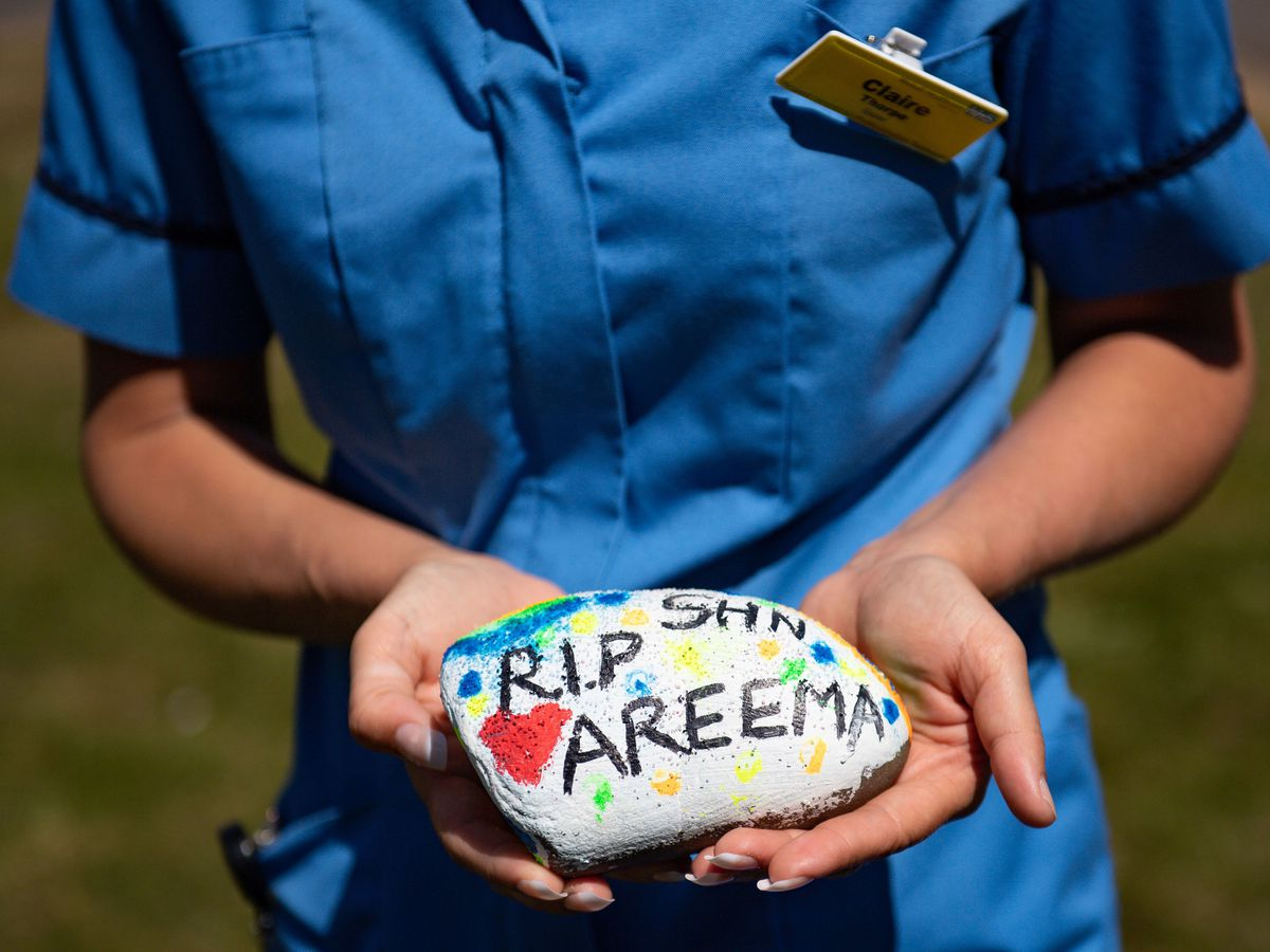 Walsall Manor ICU Nurse Claire Thorpe with a stone paying tribute to Areema Nasreen