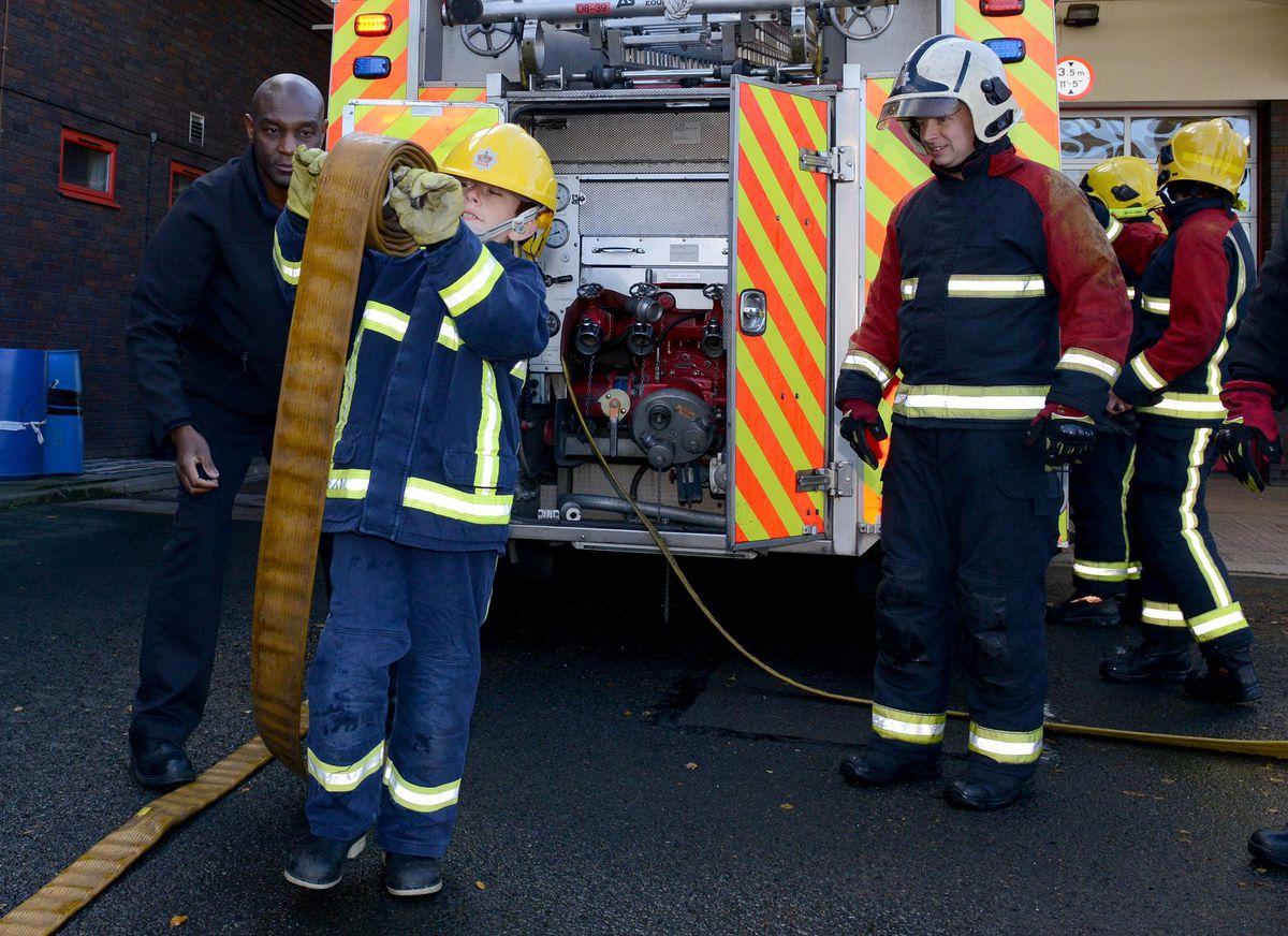 Alfie enjoying himself at West Bromwich Fire Station