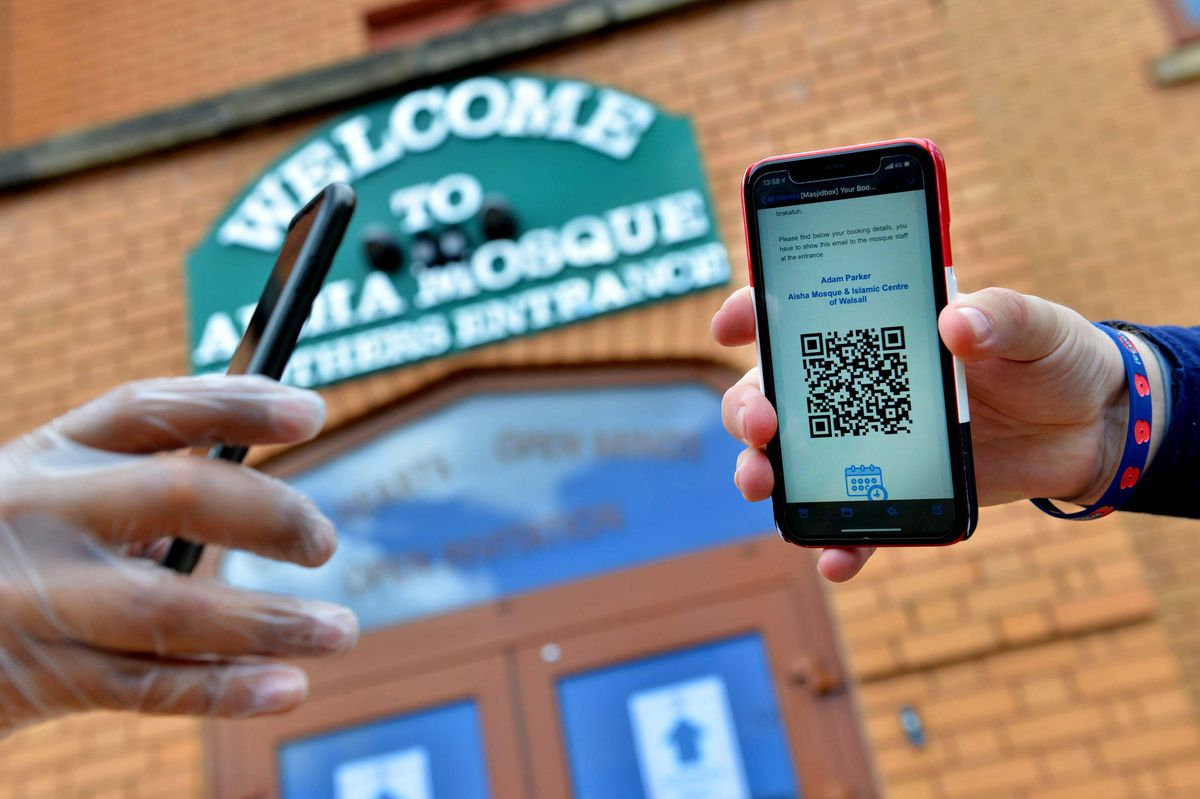 Worshippers are asked to pre-book their prayer time and a barcode is scanned before entry is allowed