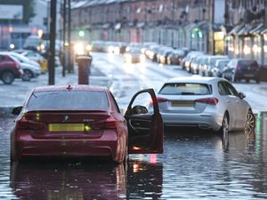 Flooded vehicles on Golden Hillcock Road in Small Heath Birmingham. (Image: SnapperSK)