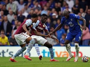 """Chelsea's Romelu Lukaku up against Aston Villa's Ezri Konsa and Axel Tuanzebe during the Premier League match at Stamford Bridge, London. Picture date: Saturday September 11, 2021. PA Photo. See PA story SOCCER Chelsea. Photo credit should read: Adam Davy/PA Wire.   RESTRICTIONS:  EDITORIAL USE ONLY No use with unauthorised audio, video, data, fixture lists, club/league logos or """"live"""" services. Online in-match use limited to 120 images, no video emulation. No use in betting, games or single club/league/player publications."""