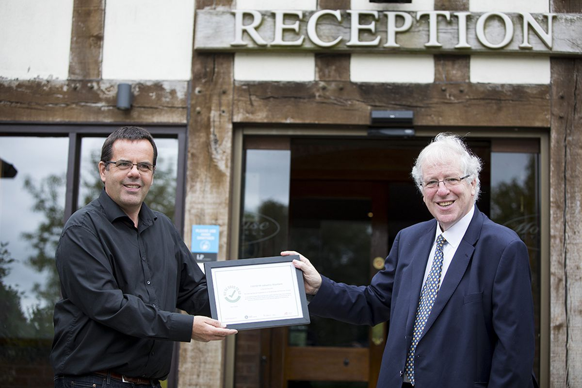 The Moat House hotel's Chris Lewis receives the 'We're Good To Go' certificate from Sir Patrick McLoughlin