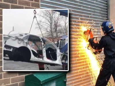 WATCH: Police cut their way into Black Country 'chop shop' and find shells of stolen cars