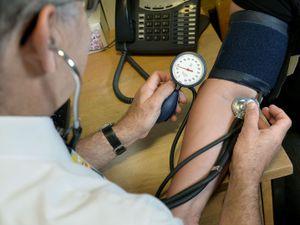 A GP checks blood pressure
