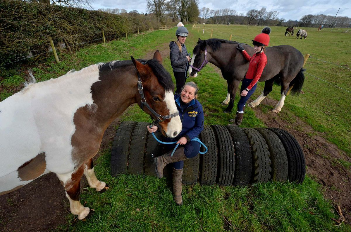 Denise O'Reilly, owner of TDS Riding Centre, with horses George and Dave, and Danielle Thomas and Jess Jennings