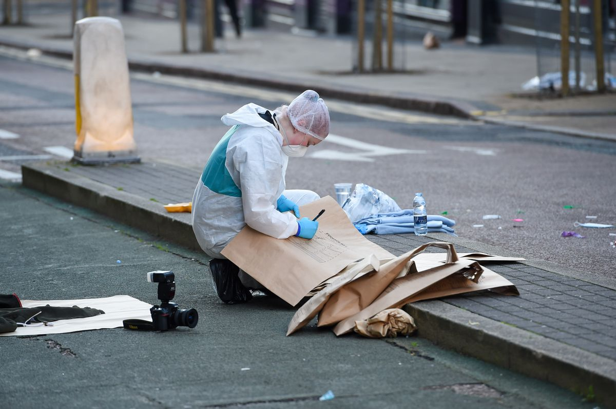 A forensics specialist in Hurst Street. Photo: SnapperSK