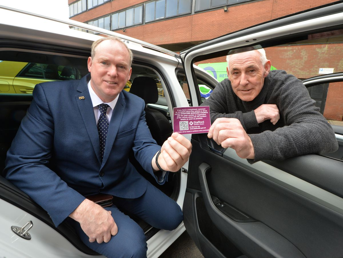 Promoting QR codes in taxis, (left) councillor Jonathan Price, and (right) chairman Stafford Taxi Association Colin Jones, at Stafford..