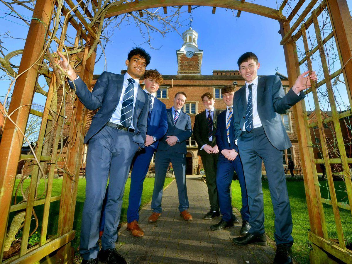 Headteacher Paul Kilbride with Nihal Ahmed-Basheer, Noah Moseley, George Robbins, Alex Holland and Ben Watkins at Old Swinford Hospital School, in Oldswinford, Stourbridge