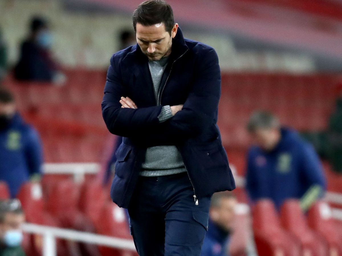 Frank Lampard appears dejected as Chelsea slip to a damaging 3-1 defeat at Arsenal on Boxing Day