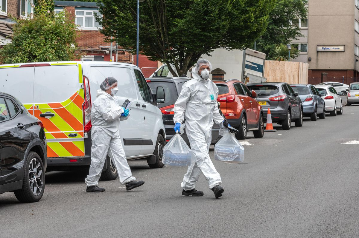 Forensic officers at the scene in Unett Street. Photo: SnapperSK