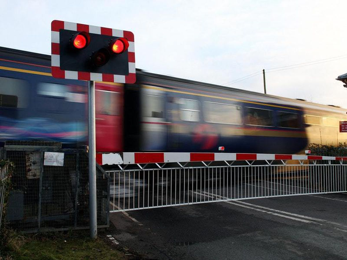 Two drivers chance lights and lives at level crossing – during TV report on subject
