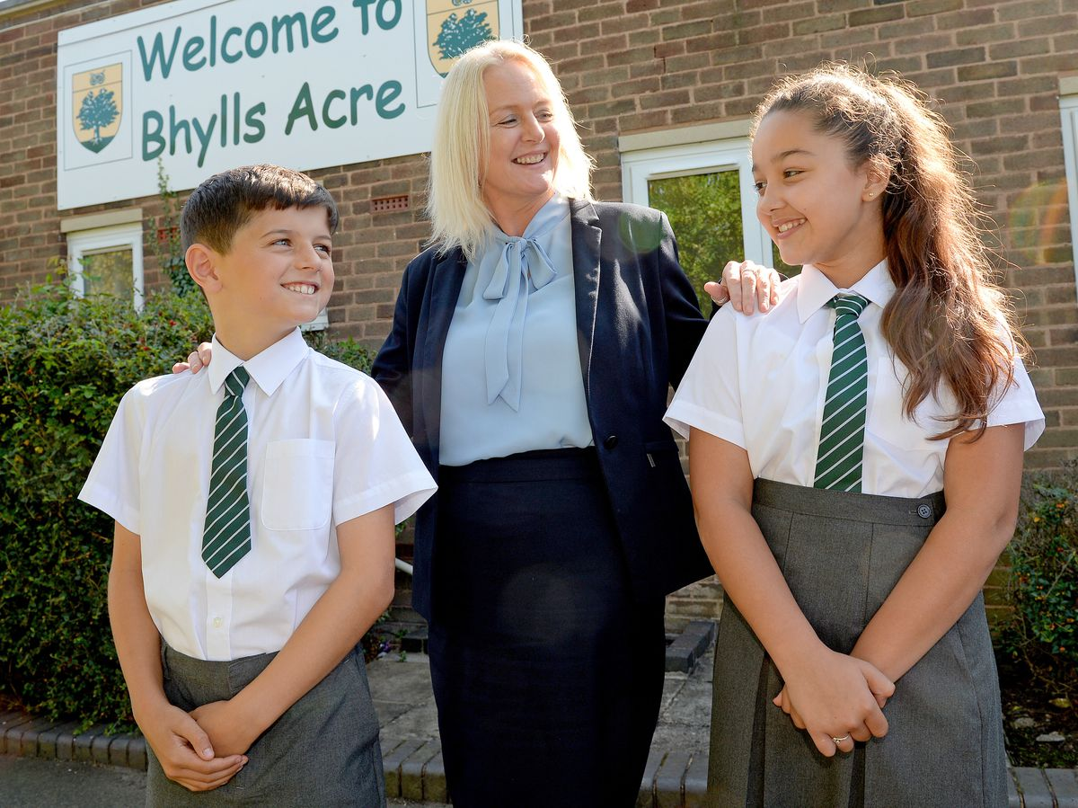 Jane Woodall, who is the new headteacher at Bhylls Acre Primary School, Wolverhampton. She is pictured with pupils Hayden Davies and Nyrah Khalil, both aged 10