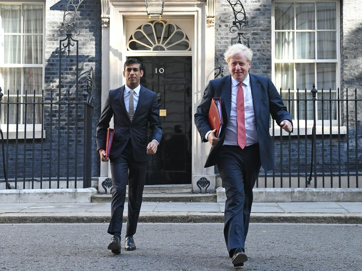 Chancellor of the Exchequer Rishi Sunak (left) and Prime Minister Boris Johnson leave 10 Downing Street