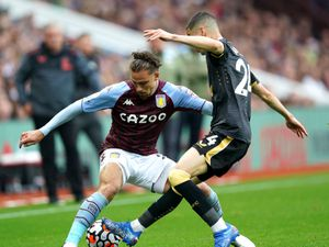 """Aston Villa's Matty Cash (left) and Newcastle United's Miguel Almiron battle for the ball during the Premier League match at Villa Park, Birmingham. Picture date: Saturday August 21, 2021. PA Photo. See PA story SOCCER Villa. Photo credit should read: David Davies/PA Wire.   RESTRICTIONS: EDITORIAL USE ONLY No use with unauthorised audio,  video, data, fixture lists, club/league logos or """"live"""" services. Online in-match use limited to 120 images, no video emulation. No use in betting, games or single club/league/player publications."""