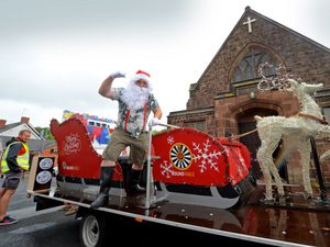 CANNOCK COPYRIGHT EXPRESS&STAR TIM THURSFIELD-27/06/20.Penkridge & District Round Table performed a summer Sleigh tour around the streets of Penkridge. They were collecting non-perishable food donations from shoppers..Pictured getting into the spirit of things is Santa aka Dan Clarke..
